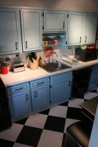 From Apartment Therapy, we're definitely doing black and white checkered floor tiles
