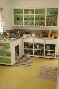 Alice's kitchen from bread&honey, I love the green cabinet interiors